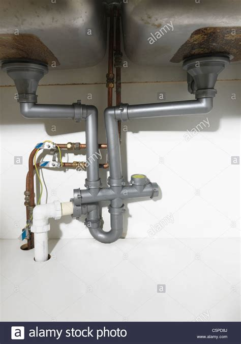 kitchen sink waste pipe waste pipe and fittings under a double kitchen sink and earth bonding stock photo royalty free