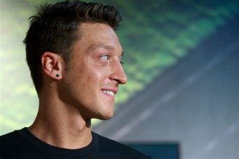 mesut ozil new haircut arsenal reach preliminary agreement to sign real madrid