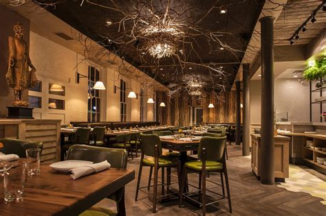 Chicago Restaurants With Private Dining Rooms nature inspired restaurant with tree branch ceiling