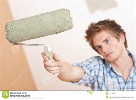 home improvement holding paint roller stock