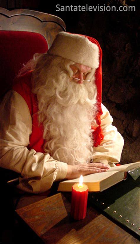 how will santa get in books picture santa claus reading a book in rovaniemi in