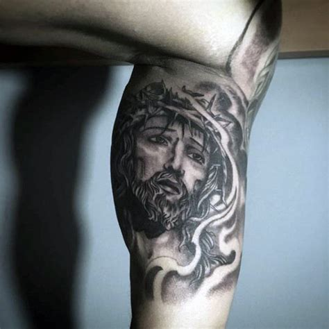 jesus tattoo on bicep 60 jesus arm tattoo designs for men religious ink ideas