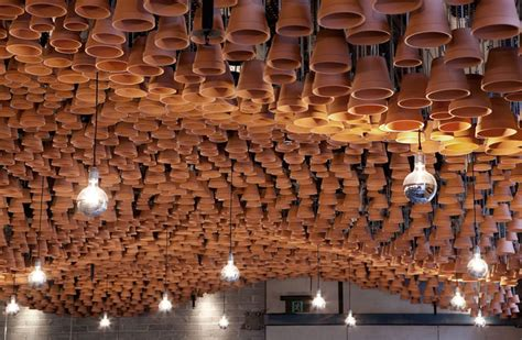 sweeping clay canopy upside pots interiorzine