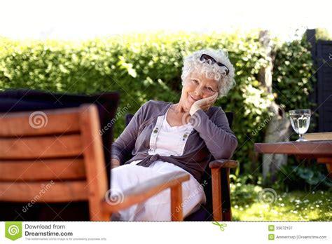 Backyard For Seniors Senior Relaxing In Backyard Garden Royalty Free