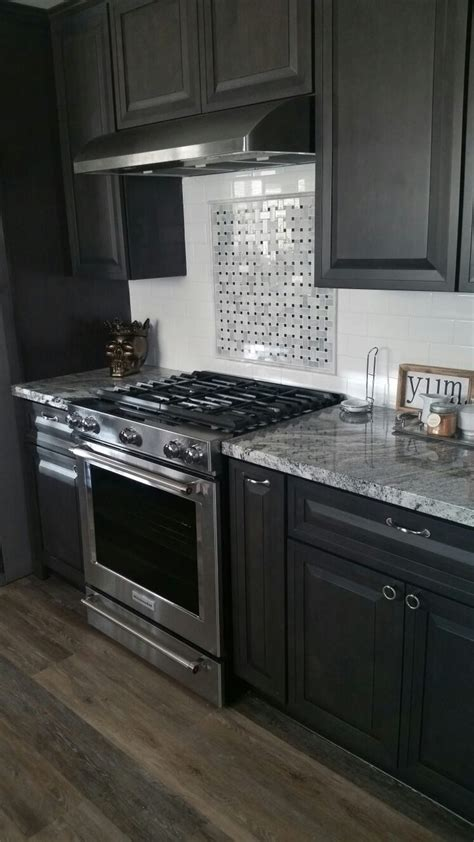 white cabinets black granite what color backsplash viscount white granite dark charcoal cabinets white