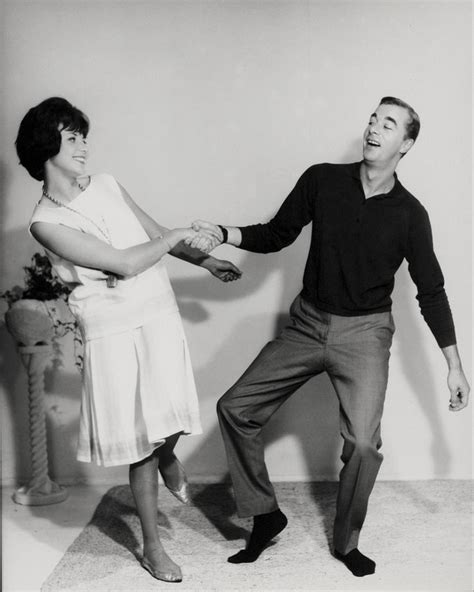 vintage dance party couple dancing the jive in the 1960s 60s party
