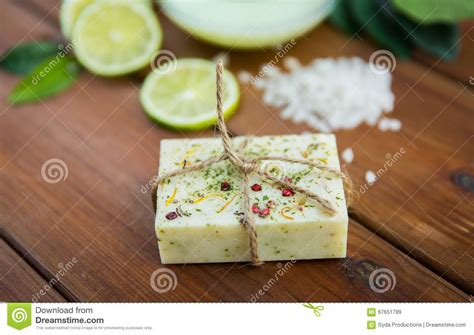 Handmade Herbal Soaps - up of handmade herbal soap bar on wood stock image
