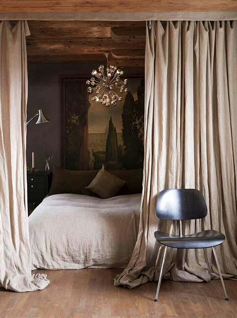 bed with curtains tuesday s tips divide that space using curtains hung from
