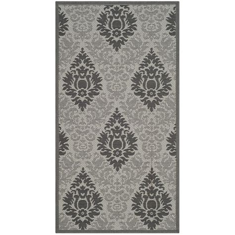 safavieh cy7529 78a5 courtyard indoor outdoor area rug light grey lowe s canada safavieh courtyard light gray anthracite 2 ft 7 in x 5 ft indoor outdoor rectangle area rug