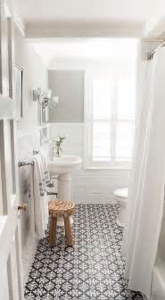 black and white bathroom floor tiles transitional
