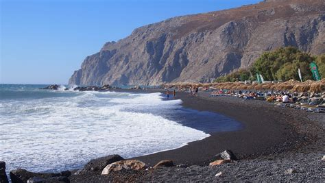 Kamari, Kamari, Greece   Black pebble beach in Santorini, Greece.