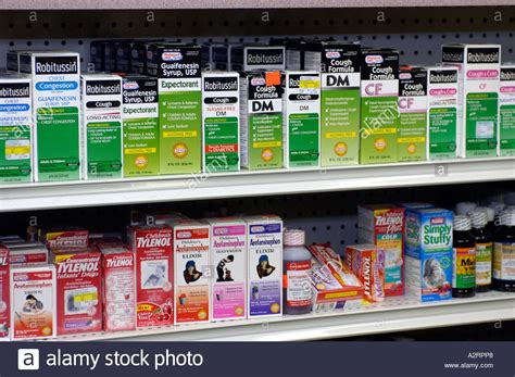 a display of cough medicines on a pharmacy shelf stock