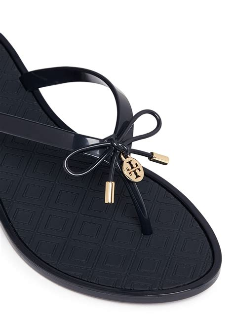 New Emboss Bio Jelly Shoes burch jelly bow embossed flip flops in blue lyst