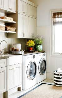 laundry room style baskets and a pull out shelf create an easy all in one area for