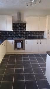 spacious cream kitchen after a  year wait new kitchen installed cream gloss slab with