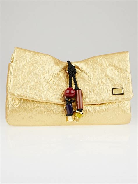 In Hilary Duffs Closet Louis Vuitton Limelight Clutch by Louis Vuitton Limited Edition Gold Monogram Limelight