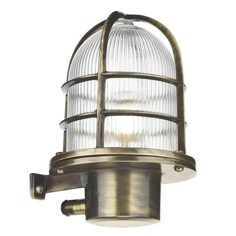 coastal style industrial exterior wall light in antique brass