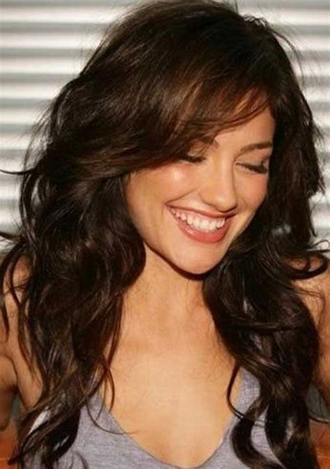 curly layers with side swept bangs long layered wavy hair long hairstyles 2015 long