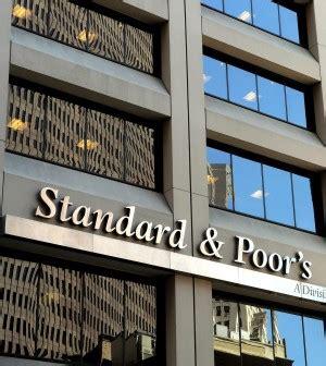 declassamento banche italiane s p taglia il rating di sette banche italiane outlook