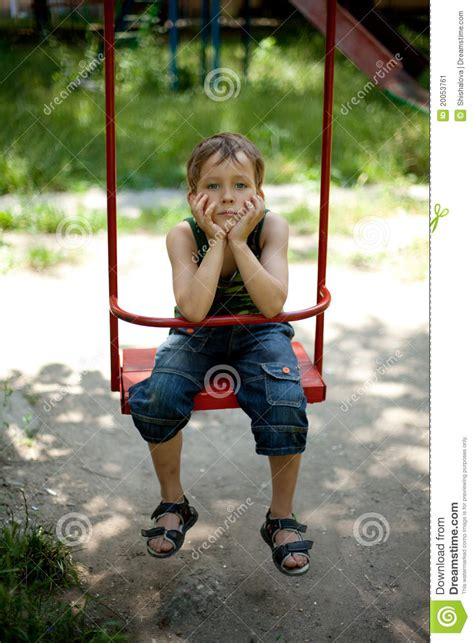 sitting on a swing little boy sitting on a swing stock image image 20053761