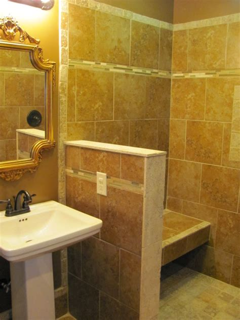 bathroom knee wall small knee wall wrapped in tile and stone gives support