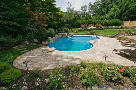 Backyard Pavers Cost Award Winning Project Showcase Freeform Vinyl Pool Spa In