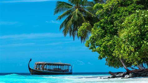 tropical island beach  boat dhigurah maldives