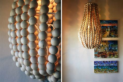 diy wooden bead chandelier how to make a wooden chandelier brit co
