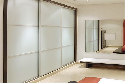 Wardrobe Manufacturers Uk by Sliding Wardrobe Doors In White Gloss White Glass And