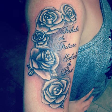 rose upper thigh tattoo