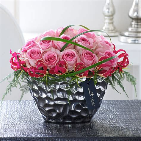 Luxury Pink luxury pink and gloriosa arrangement sweeneys florist