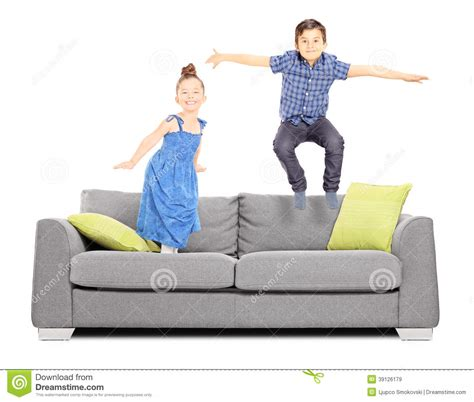 jumping on the sofa boy and a girl jumping on the couch stock image image of