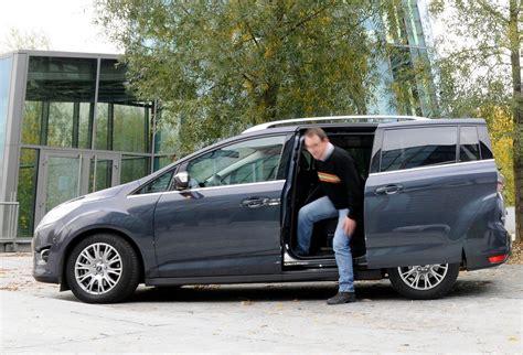 voiture 7 places porte coulissante essai comparatif ford grand c max contre peugeot 5008