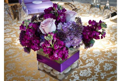 small purple flower arrangements for wedding table amethyst inspired christening celebration