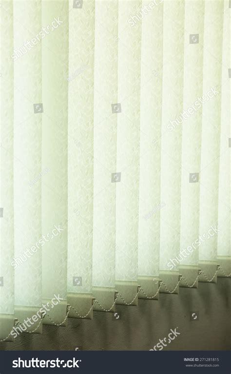 curtain shutter shutter curtain against sun light on window stock photo