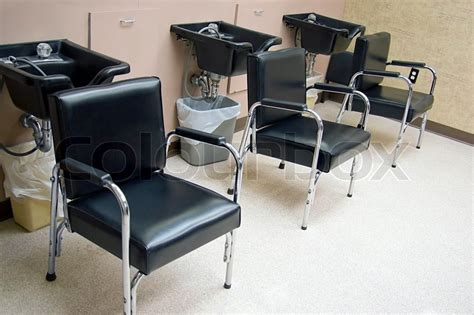 shoo sink and chair hair salon a row of hair washing sinks and chairs