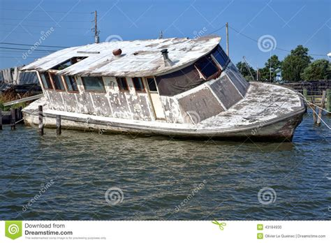 sinking boat docks abandoned derelict boat sinking after hurricane stock