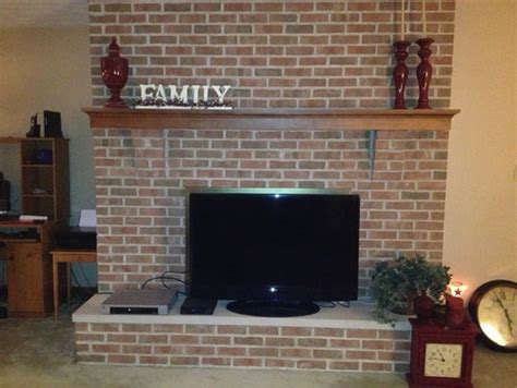 tv in front of fireplace in need of fireplace mantel decor ideas