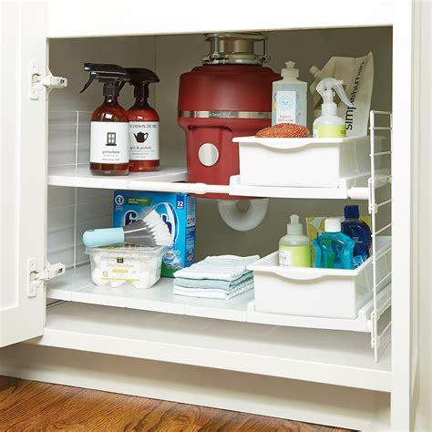 under sink shelf organizer iris expandable under sink organizer the container store