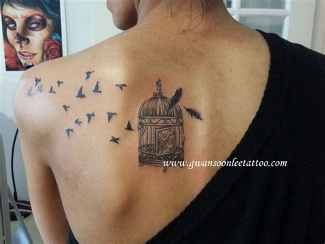 feather tattoo shoulder blade birds with bird cage and feather tattoo design gwan soon