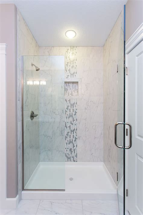 bathroom tile strips this beautiful tiled shower features modern glass doors