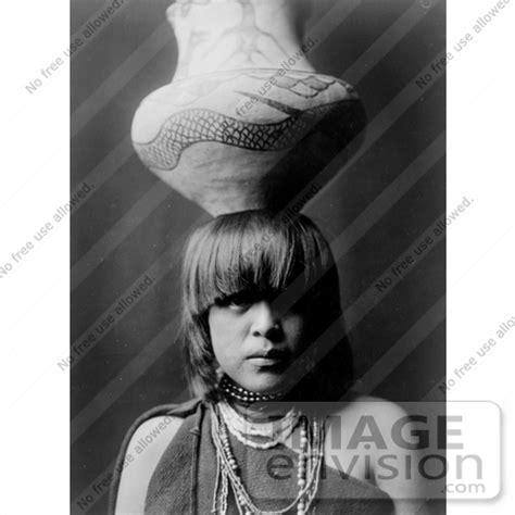 stock photography of a pueblo san ildefonso girl balancing