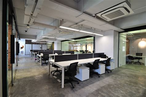 a cool raw office design modern home office hong kong by the grene group