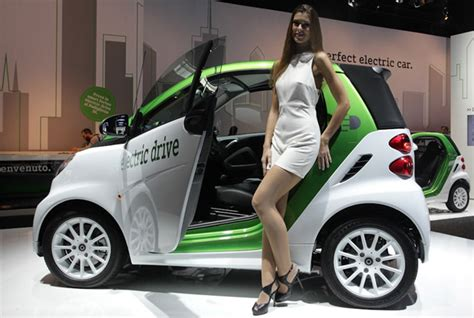 electric smart car cost dull display of electric cars at italy s bologna motor
