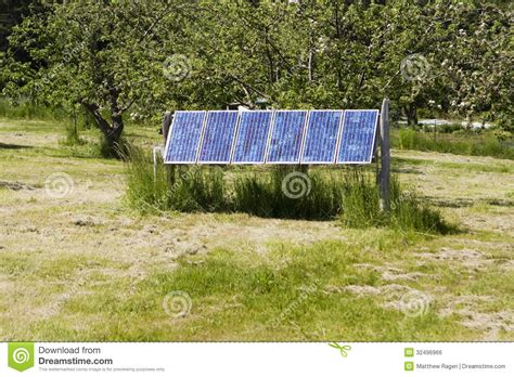 solar panels against green background royalty free stock