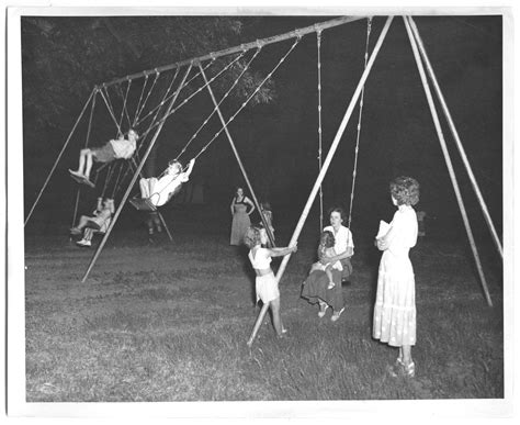 history of swinging photograph of children swinging at a dallas park the