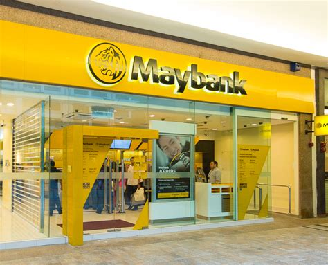 may bank in uk maybank revises loan growth return on equity