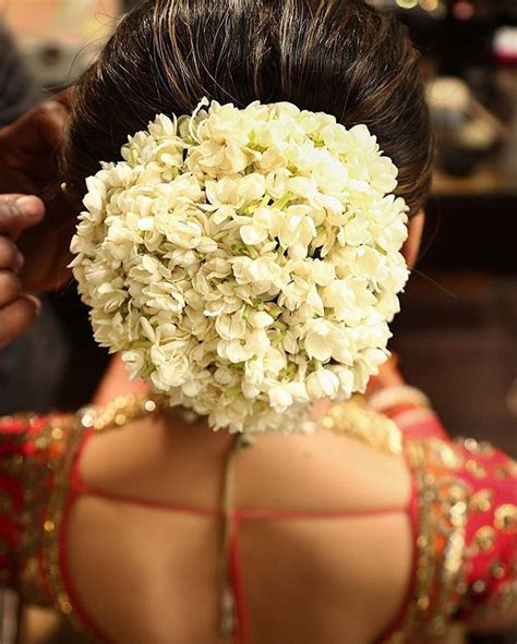 indian hairstyles with jasmine flowers what a beautiful large low bun covered with real flowers