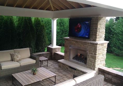 Outdoor Gas Fireplace With Television by Fine's Gas