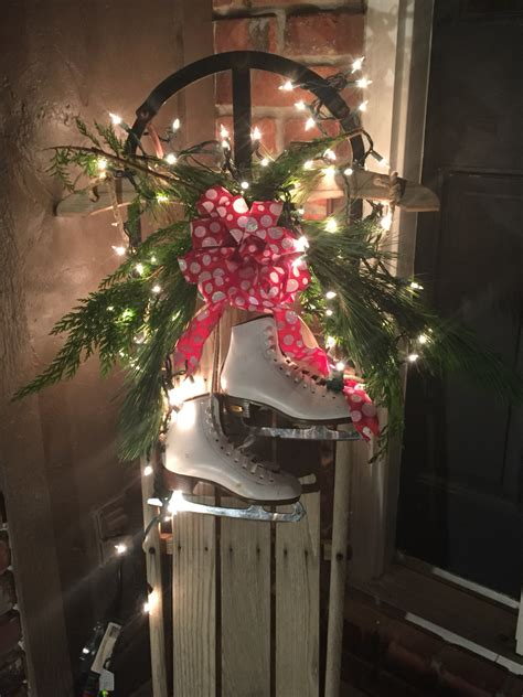 old wooden sled decor made with fresh greenery lights